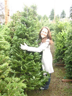 then we headed to fred meyer for a tree stand and skirt sadly we didnt buy a tree skirt because they only had heinous ones with big pictures of santa on