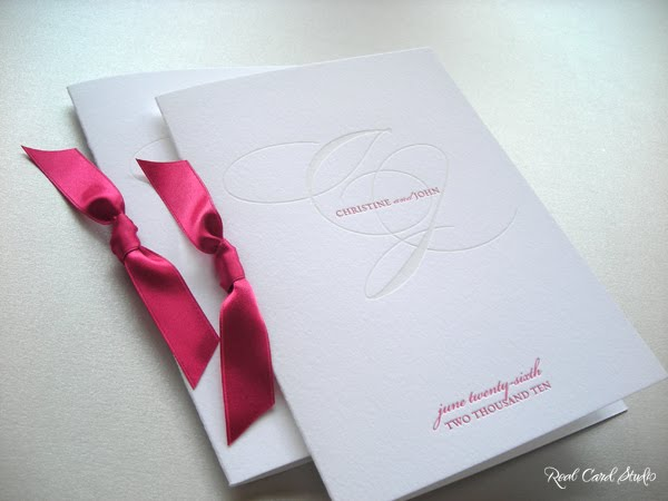 Wedding programs with fuchsia pink satin ribbons and