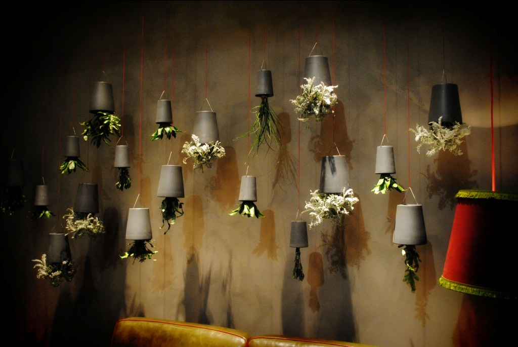 again dont remember the booth but these upside down plants hanging from the ceiling could be a lovely avant garde decor for a party ceiling avant garde