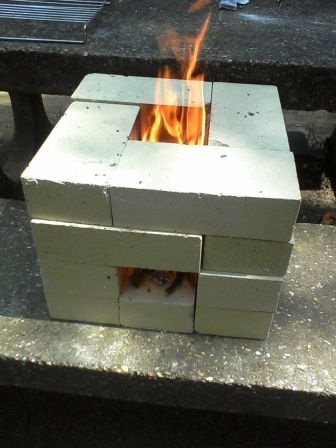 The mama crow simple living adventure my rocket stove for How to make a rocket stove with bricks