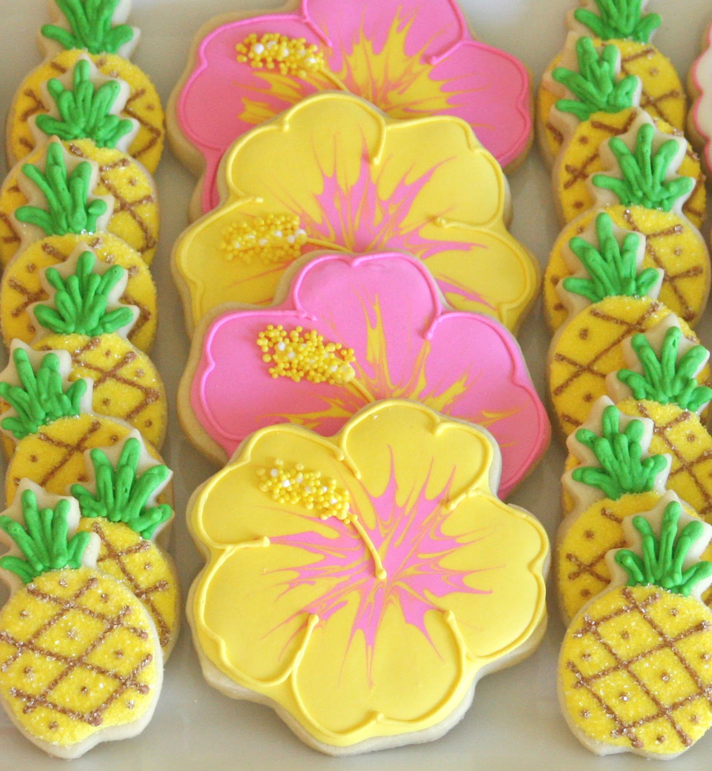 Cookie decorating how to make pretty hibiscus cookies glorious treats im here today to show you how to decorate hibiscus cookies like the ones i included in my luau dessert buffet last weekend izmirmasajfo