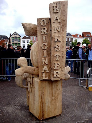 wood sculpture that says original bankster on it
