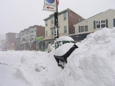 nasty snowy weather with a mailbox almost completely covered by snow