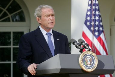Bush speaking at podium in front of White House