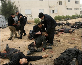 Palestinians aiding the wounded, surrounded by corpses