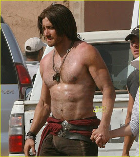 Jake Gyllenhaal shirtless and very serious