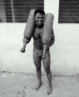 hunk from India holding heavy weights
