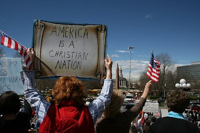 Idiot with sign that says America is a Christian Nation