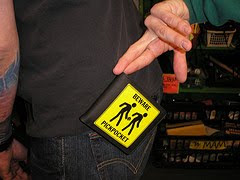 clowning around with a wallet with a pickpocketing warning on it