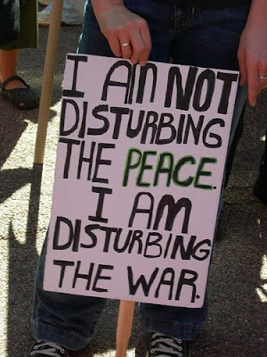 sign that says I'm Not Disturbing the Peace. I'm disturbing the war.