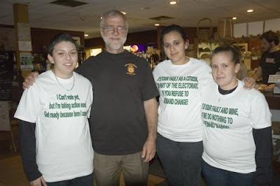 Howie Hawkins standing with supporters