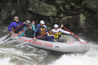 ACA Legends of Paddling Award Recipient Payson Kennedy guides a group of ACA members through Nantahala Falls