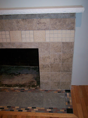 completed fireplace tiling