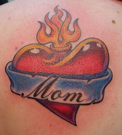 mom heart tattoo on his arm,