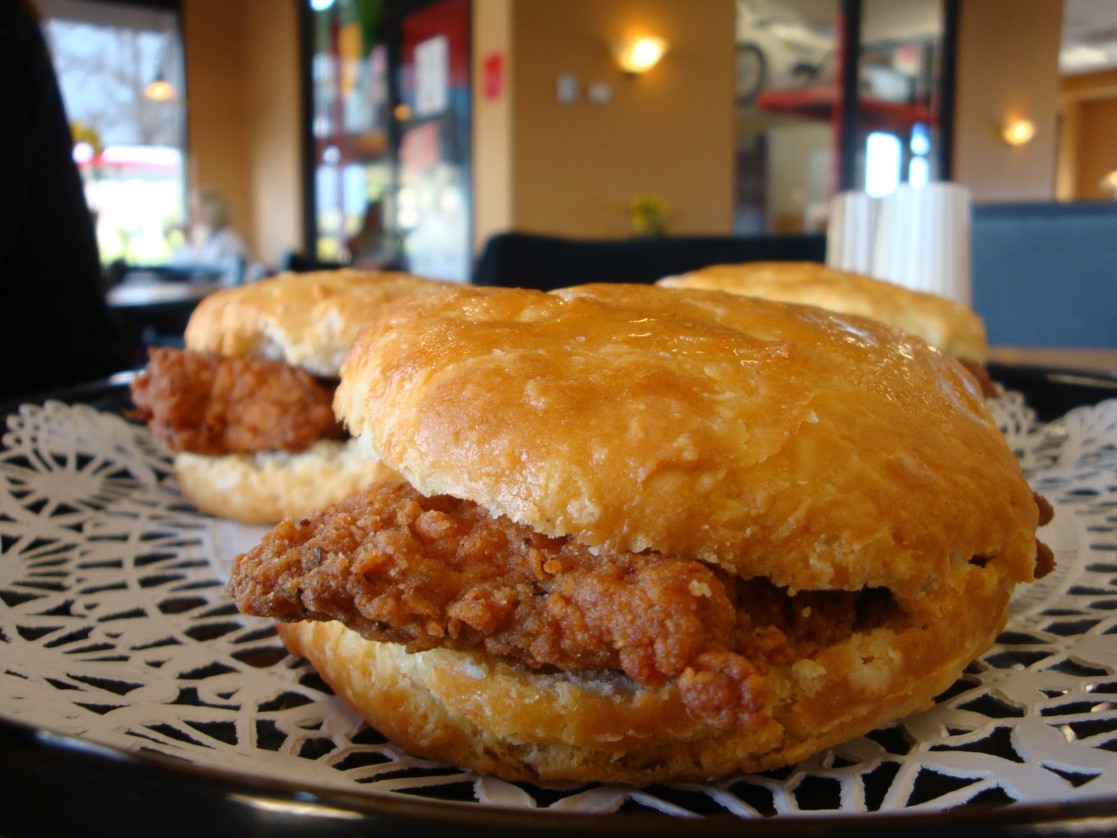 the hand breaded spicy chicken biscuit features a boneless chicken
