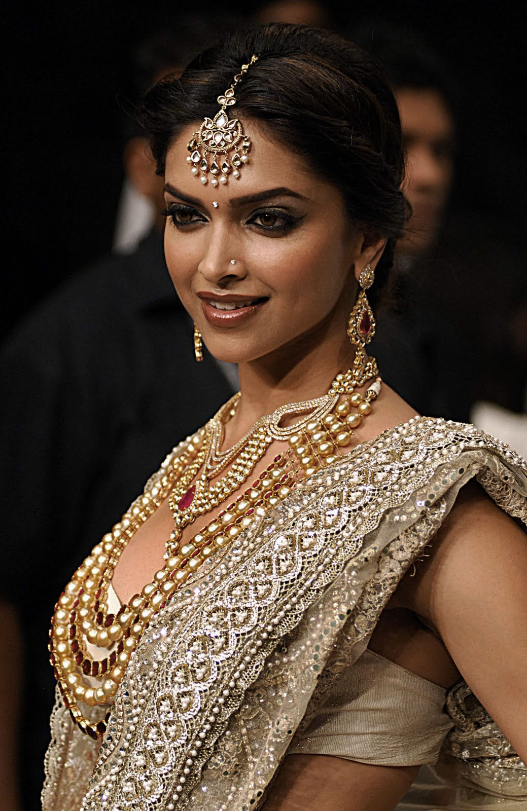 Wearing a stunning gold colour net lehanga and sparkling kundan