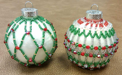 Two white ornaments with red and green beads