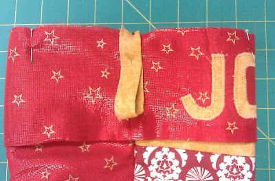 Band and loop pinned to top of stocking