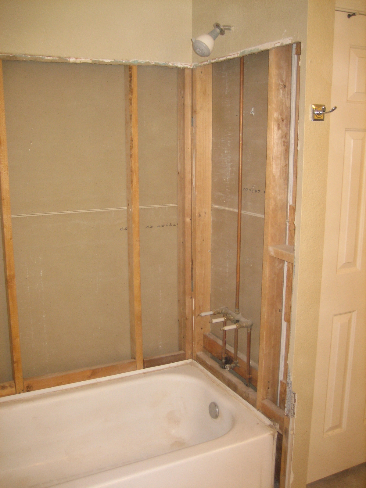 tore out the backer board and built 2 boxes for inset shower shelves