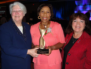 Norma Rist Past Chair of ATHENA International stands with Daisy Alford-Smith Executive Director of the Girl Scouts of North East Ohio and the Akron area 2010 ATHENA International Leadership Award Recepient and Dianne Dinkel ATHENA International President CEO