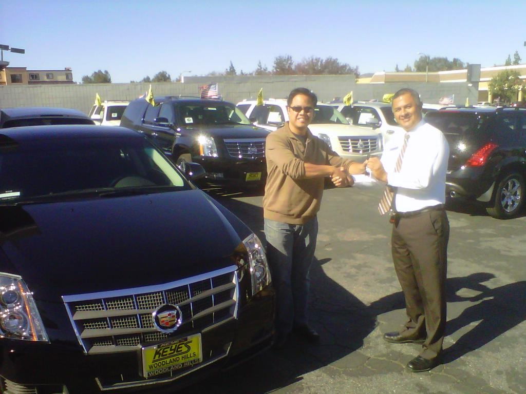 Keyes woodland hills buick gmc cadillac would like ot congratulate price is right winner jonathan soriano here you see sales consultant walter chinchilla