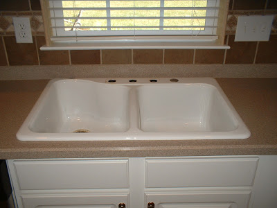 Replace Drop In Sink With An Undermount Sink.