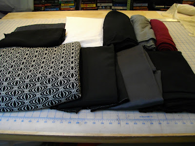 from upper left black stretch denim black wool for trim on the sweater coat white poplin black wool knit from michaels gray wool rayon jersey