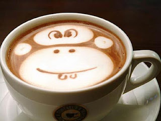 funny monkey face on coffee
