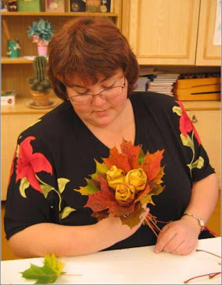 a woman creating a maple leaf flower craft