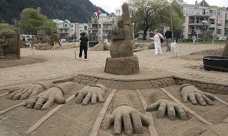 multi hand sand sculpture