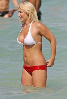 Brooke Hogan in a red and white bikini