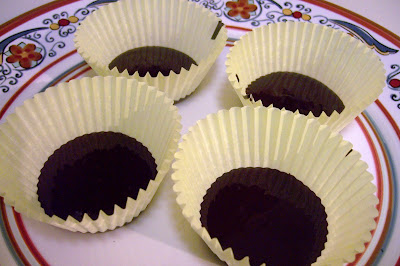 Chocolate in bottom of paper cupcake liners