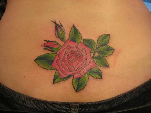 Large colorful rose cluster on shoulders and chest breasts