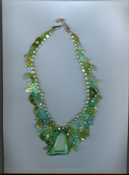 green Beach Glass surrounded by fresh water pearls and  beads of all sizes and shapes