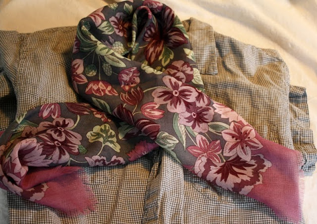Checked shirt and flowered scarf