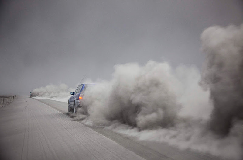 A car is seen driving near Kirkjubaejarklaustur, Iceland, through the ash from the volcano eruption under the Eyjafjallajokull glacier on Thursday April 15, 2010. (AP Photo/Omar Oskarsson