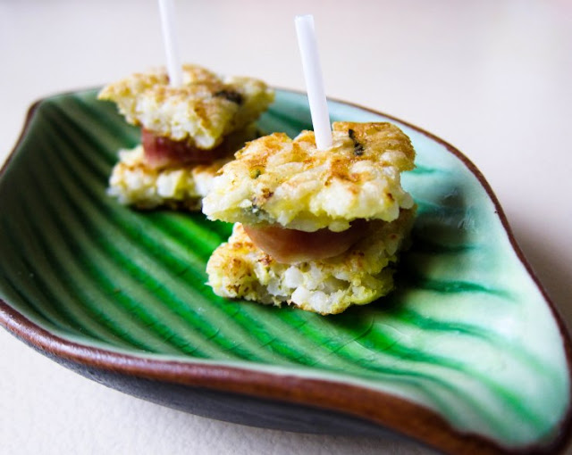 ... , made with pan-fried eggy crispy rice cakes and steamed lap cheong