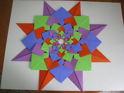 Tomoko Fuse's Origami Quilt Blooming Flowers 1 in Orange, Green, Blue, and Purple