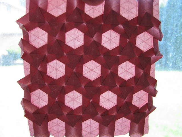 Eric Gjerde Red Double Pleat Hexagon Tessellation window lit front