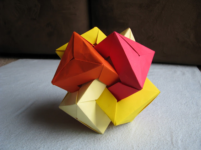 Daniel Kwan Four Interlocking Triangular Prisms Red to Yellow