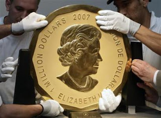 Queen Elizabeth on the largest gold coin ever.