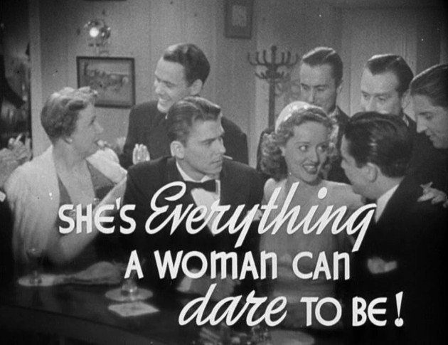 old movie still with caption that reads, She's everything a woman could dare to be!