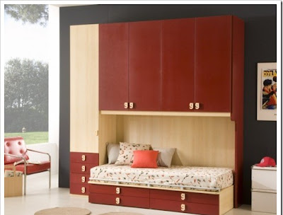 stylish kids room for girls decorated in red, red cabinets and red chair