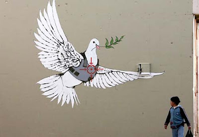 Bansky graffiti bird in Bethlehem