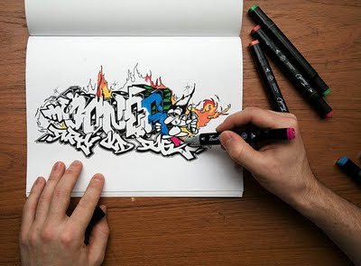 Creator Writing Graffiti Alphabets on Book