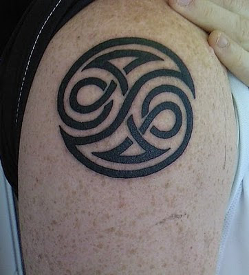 Ying Yang Tribal Tattoos Desings