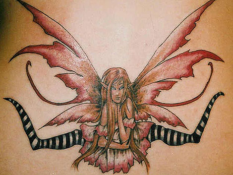Heart And Butterfly Tribal Tattoo Lower Back For Girls