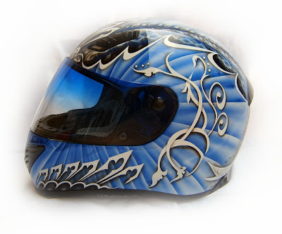 Blue skull airbrushed designs on sport helmet 3