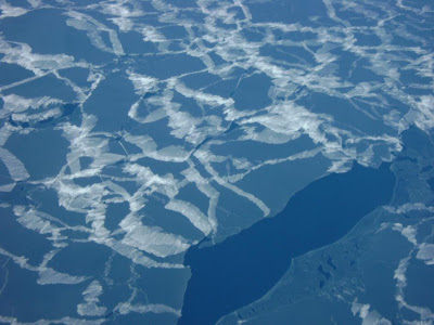 Thin ice is spotted from NASA's DC-8 aircraft from an altitude of 1,500 feet during a successful flight over Antarctica's Pine Island Glacier under blue-sky conditions