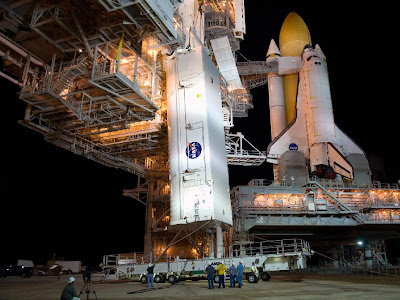 Payload canister is delivered to Launch Pad 39A where space shuttle Atlantis stands